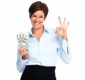 Femme mûre avec l'argent américain des dollars Image libre de droits