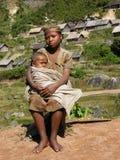 Femme malgache avec elle babay Images libres de droits