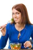 Femme mangeant de la salade végétale photographie stock
