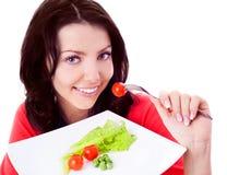 Femme mangeant des légumes Images libres de droits