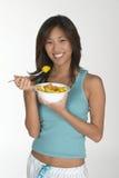 Femme mangeant mellon Photographie stock libre de droits
