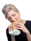 Femme mangeant un sandwich Image libre de droits