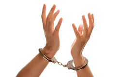 Femme menotté soulevant des mains en air sur le blanc Images stock