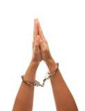 Femme menotté soulevant des mains en air sur le blanc Photos libres de droits