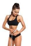 Femme mesurant les hanches Images stock