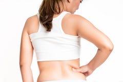 Femme mesurant sa graisse de ventre Image libre de droits