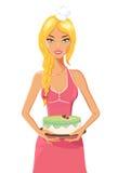Femme mignonne dans un chapeau de chefs avec le gâteau de fraise illustration libre de droits