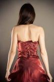 Femme mince dans un corset image stock