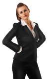 Femme moderne fâché d'affaires avec des mains sur des gratte-culs Image stock