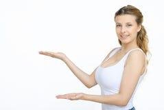 Femme montrant quelque chose avec la paume ouverte de main Photos stock