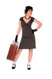 Femme nerveux avec une valise Photographie stock libre de droits