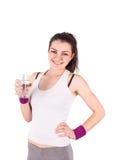 Femme par verre d'aérobic d'eau Photographie stock libre de droits