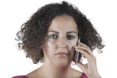 Femme parlant au téléphone Photos stock