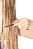 Femme peignant le cheveu photos stock