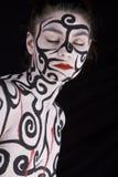 femme peinte par fuselage Photo stock