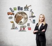 Femme pensant à l'environnement, icônes de production de pétrole derrière il Images stock