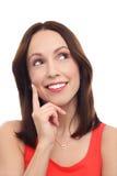 Femme pensant avec le doigt sur le menton Image stock