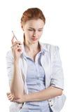 Femme pensant avec un stylo Images libres de droits
