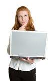 Femme pensante d'ordinateur portatif Image stock