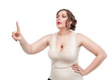 Femme plus de taille faisant le choix Image libre de droits