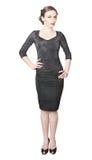 Femme portant la robe noire serrée Image libre de droits