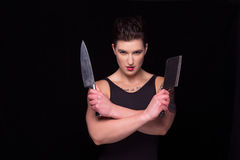 Femme posant avec des couteaux Images libres de droits