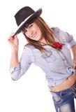 Femme posant avec le chapeau Photo stock