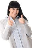 Femme positive heureuse gaie heureuse avec des pouces  Photographie stock libre de droits