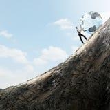Femme poussant la planète Photo libre de droits