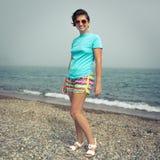 Femme près de la mer Photos stock