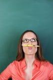Femme réfléchie avec une moustache de crayon image libre de droits