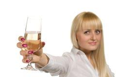 Femme réussie avec une glace de champagne Photographie stock libre de droits