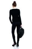 Femme réussie heureuse d'affaires dans le costume noir avec le sac Photo libre de droits