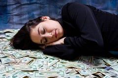 Femme rêvant de l'argent Photographie stock libre de droits