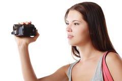 Femme regardant le videocame Image libre de droits