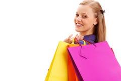 Femme retenant des sacs à provisions Photo stock