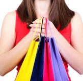 Femme retenant des sacs à provisions Photo libre de droits