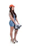 Femme retenant la scie de circulaire Photo libre de droits