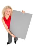 Femme retenant le signe blanc Image stock