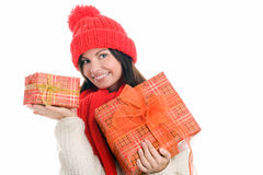 Femme retenant le sourire de deux cadeaux Image stock