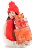 Femme retenant le sourire de trois cadeaux Photographie stock libre de droits