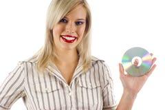 Femme retenant un CD Image libre de droits