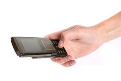 Femme retenant un téléphone portable Photos libres de droits