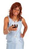 Femme retenant une glace de vin rouge Photo stock