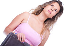 Femme retenant une serviette et penser Photos libres de droits