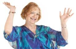 Femme riant avec des mains vers le haut Photographie stock