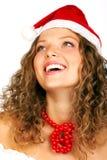 Femme riant dans le capuchon de Santa Photos stock