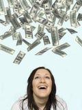 Femme riant de la pluie d'argent Photographie stock