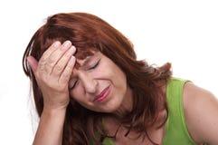 Femme roux avec la migraine Photographie stock libre de droits