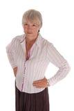 Femme sérieuse d'affaires avec des mains sur des gratte-culs Images libres de droits